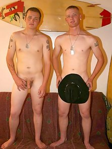 A pair of tattooed twinks getting naked together