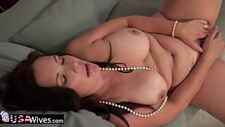 Chubby Lady Masturbating with Huge Dildo on Soft Couch